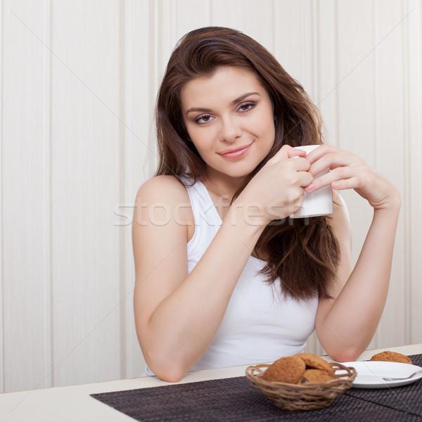beautiful woman enjoying tea and cookies Stock photo © chesterf
