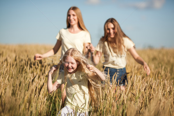 mother and daugthers run on wheat filed Stock photo © chesterf