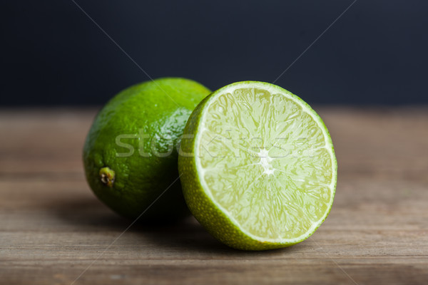 green lime on wooden rustic table Stock photo © chesterf