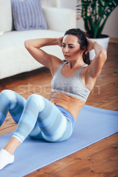 mid adult woman training abdominals at home Stock photo © chesterf
