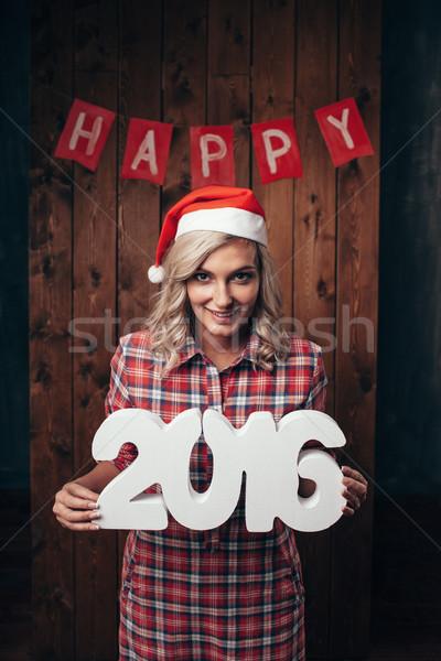 happy blonde woman holding 2016 numbers Stock photo © chesterf