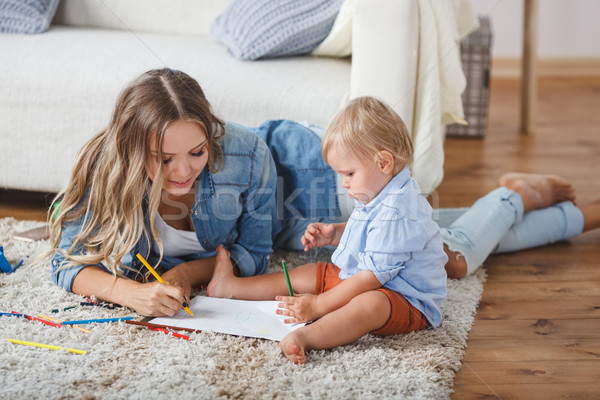 Mother and son paint the walls and floor. Children's creativity. Stock photo © chesterf
