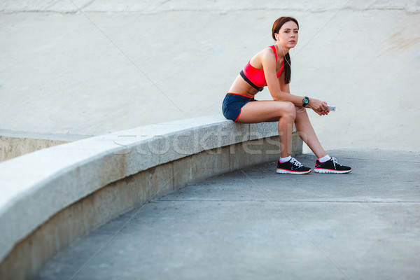sitting tired sporty woman Stock photo © chesterf