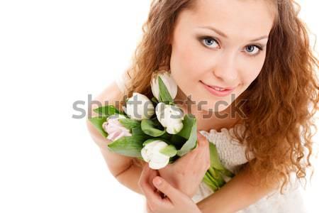 Boldog nő tart fehér tulipánok hosszú hajú Stock fotó © chesterf