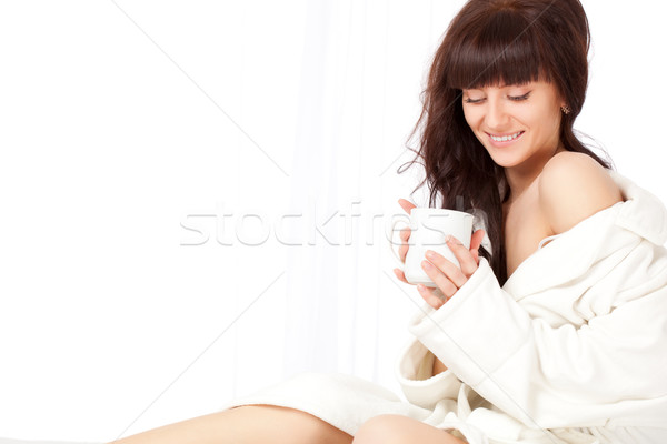 woman with white mug wearing dressing gown Stock photo © chesterf