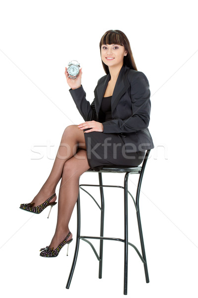 woman holding alarm sitting on chair Stock photo © chesterf