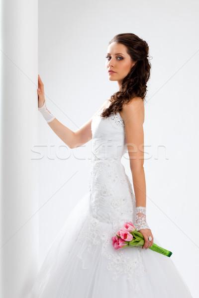 beautiful bride standing near column Stock photo © chesterf
