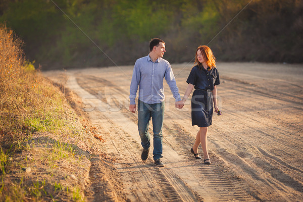 couple walking along the dirt road Stock photo © chesterf