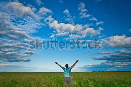 man on field under skies Stock photo © chesterf