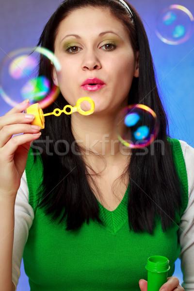 Vrouw zeepbellen Blauw handen glimlach Stockfoto © chesterf