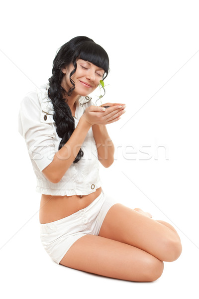 woman holding green plant Stock photo © chesterf