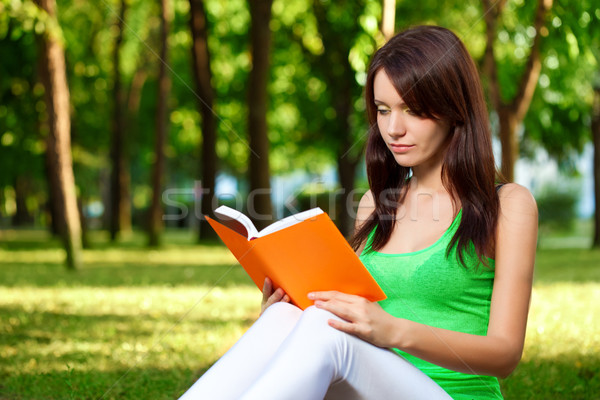 woman reading book at park Stock photo © chesterf