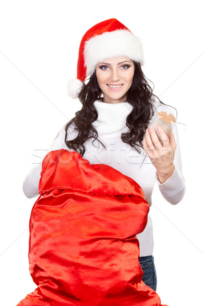 woman getting the gift from big red sack Stock photo © chesterf