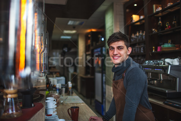 Barista homme portrait derrière bar café Photo stock © chesterf