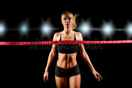 Stock photo: woman lifting red dumbbells