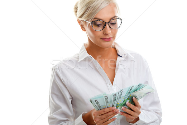 seriously young woman holding euro bills Stock photo © chesterf
