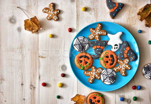 Bonbons cookies heureux halloween table Photo stock © choreograph