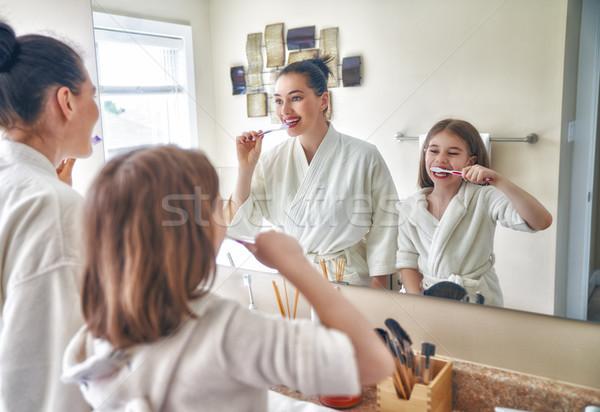 family are brushing teeth Stock photo © choreograph