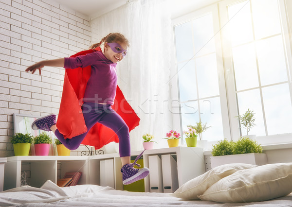 girl in an Superman's costume Stock photo © choreograph