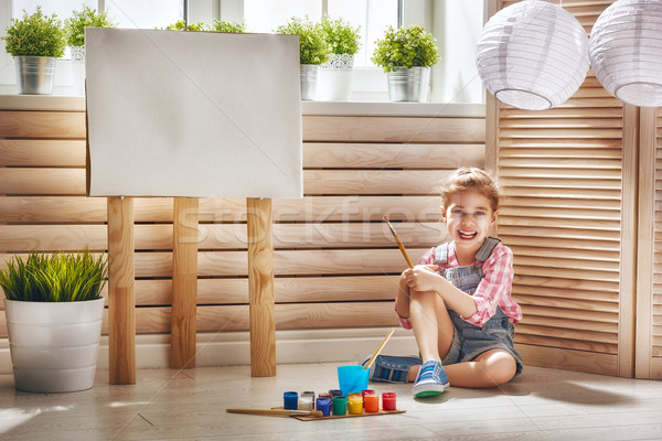 child draws paints Stock photo © choreograph