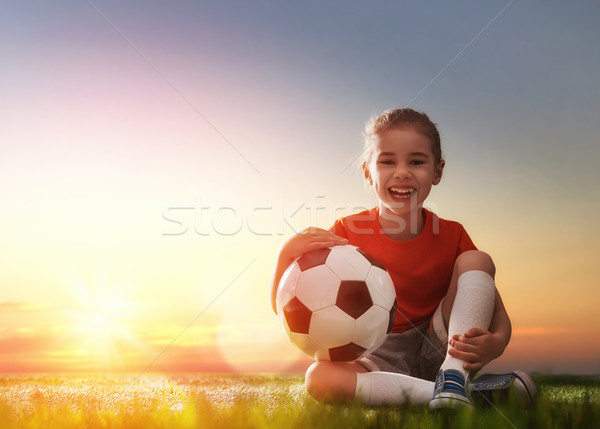 Child plays football. Stock photo © choreograph