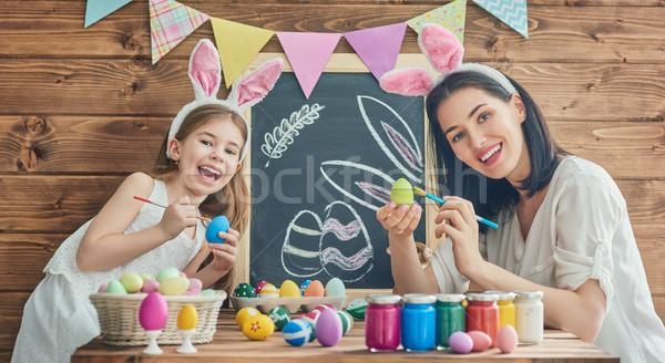 Család húsvét anya lánygyermek festmény tojások Stock fotó © choreograph