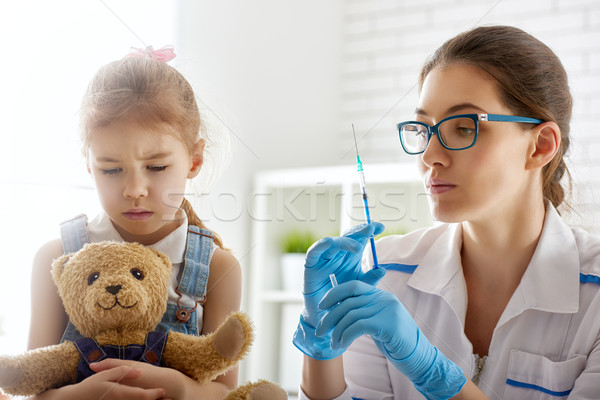 a vaccination to a child Stock photo © choreograph