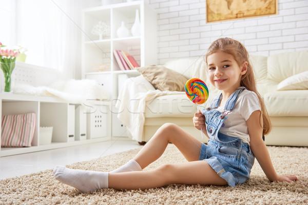 girl eating candy Stock photo © choreograph