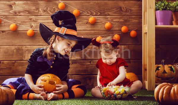 sisters celebrate Halloween Stock photo © choreograph