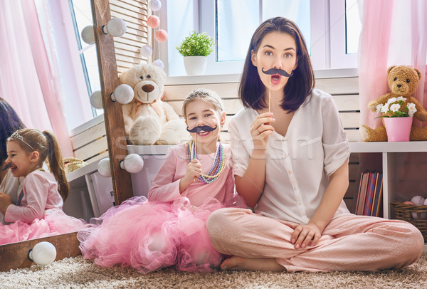 Stock photo: Funny family playing at home