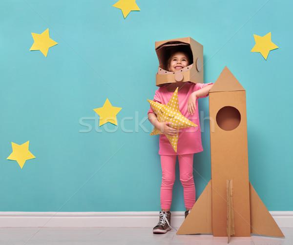 Dziewczyna astronauta kostium dziecko zabawki rakietowe Zdjęcia stock © choreograph