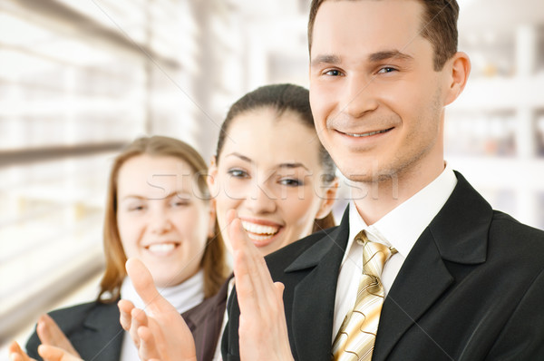 Zakenlieden team geslaagd glimlachend jonge kantoor Stockfoto © choreograph