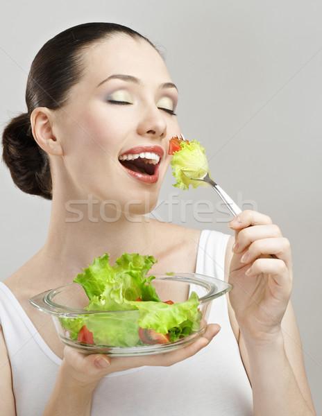Bella snello ragazza mangiare sano alimentare donna Foto d'archivio © choreograph
