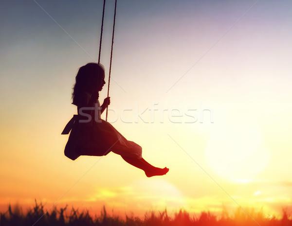 Bambino ragazza swing felice tramonto estate Foto d'archivio © choreograph