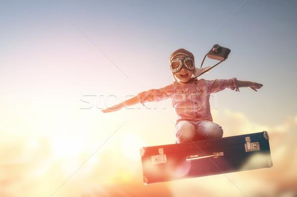 Marzenia podróży dziecko pływające walizkę tle Zdjęcia stock © choreograph