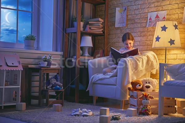 girl reading a book Stock photo © choreograph
