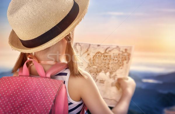 Wenig Reisenden kleines Mädchen Karte Sonnenuntergang Kind Stock foto © choreograph