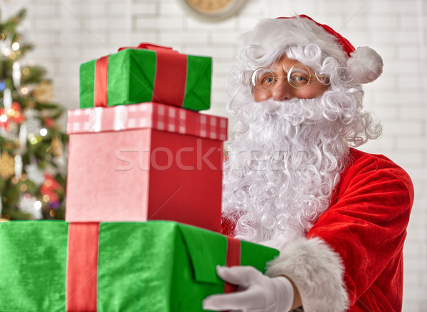 Santa Claus with christmas gifts Stock photo © choreograph