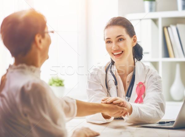 Pacjenta słuchania lekarza rak piersi świadomość Zdjęcia stock © choreograph