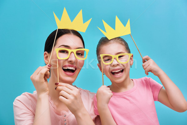 Stock photo: Mom and child are holding crowns