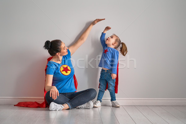 Mother is measuring growth of child Stock photo © choreograph