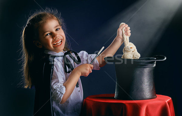 Magik mały uśmiech szczęśliwy dziecko zabawy Zdjęcia stock © choreograph