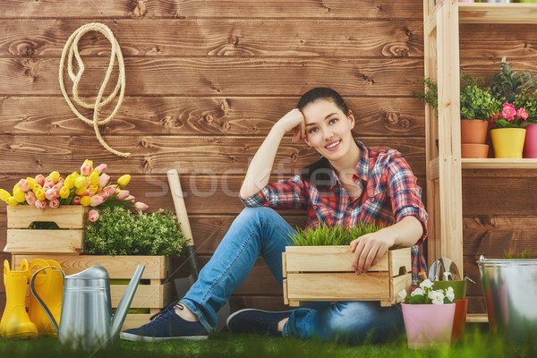 woman caring for her plants Stock photo © choreograph