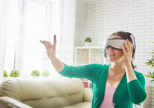 woman in virtual reality glasses. Stock photo © choreograph