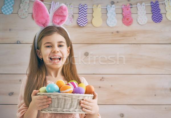 Girl holding basket with eggs Stock photo © choreograph
