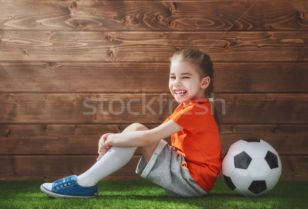 Girl plays football. Stock photo © choreograph