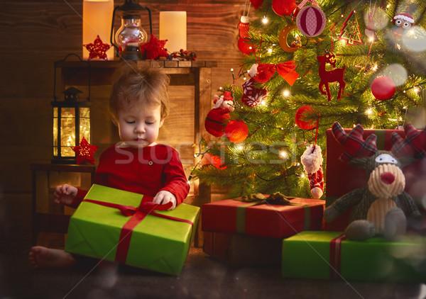 baby girl with Christmas present Stock photo © choreograph