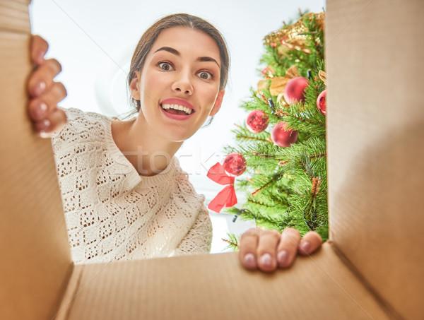 woman opening a Christmas present Stock photo © choreograph