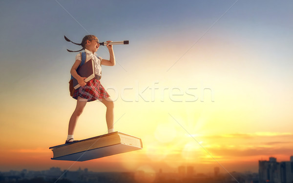 child flying on the book Stock photo © choreograph