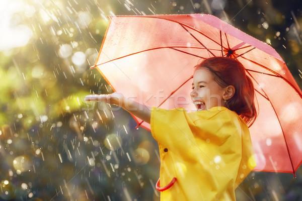 Stock photo: child with red umbrella